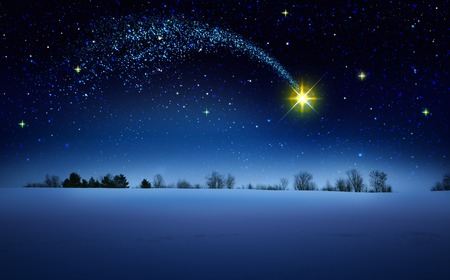 Christmas Star and blue abstract sky.Christmas background.
