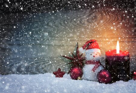 Photo pour Christmas snowy background with fourth Advent candle and Snowman . - image libre de droit