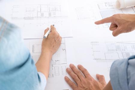 Foto de Image of engineer teamwork meeting for architectural project at a workplace - Imagen libre de derechos