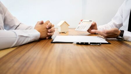 Photo for Real Estate agent showing a contract signature with customer to making a valuation deal - Royalty Free Image