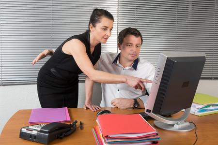 Photo pour The manager flirting with attractive His secretary - image libre de droit