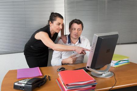 Photo pour Business Colleagues Working At Desk - image libre de droit