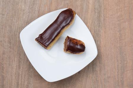 Tasty french chocolate Eclair cut in half