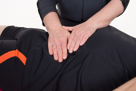 Position of hands and fingers at lymphatic drainage massage of a male body