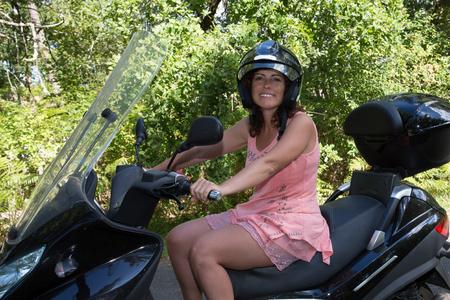 Portrait of smiling girl on motorbike - Outdoor on street .