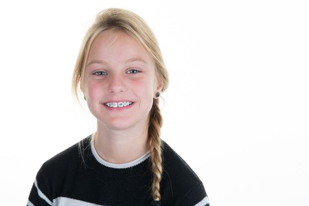 Pretty blond Teen or child girl isolated on white background