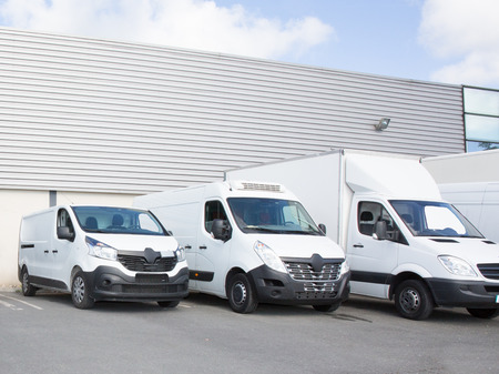 Photo pour specialized delivery society parking with small trucks and van - image libre de droit