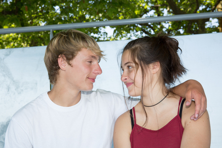 Young happy funny couple lovely posing and kissing outdoor