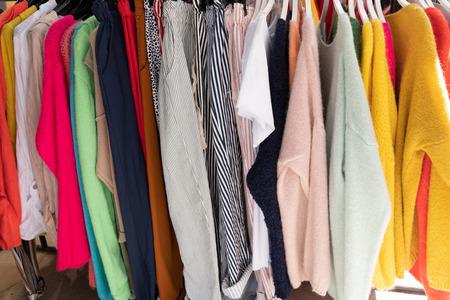 Photo pour Collection of clothes hanging on rack - image libre de droit