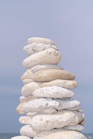 Foto de stone pyramid on sky beach Zen rock in concept of balance and harmony - Imagen libre de derechos