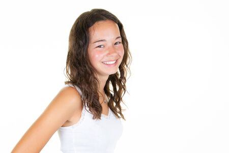 Photo for Portrait of cheerful curly brunette teenager girl laughing - Royalty Free Image