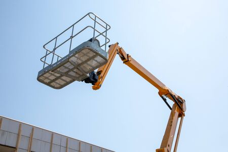 Photo for Lift basket Boom lift and work aerial platform - Royalty Free Image