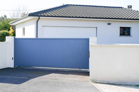 Photo for Automatic Sliding grey gate modern house - Royalty Free Image