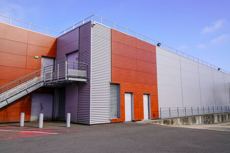 Photo pour exterior of  building company headquarters with a warehouse commercial office - image libre de droit