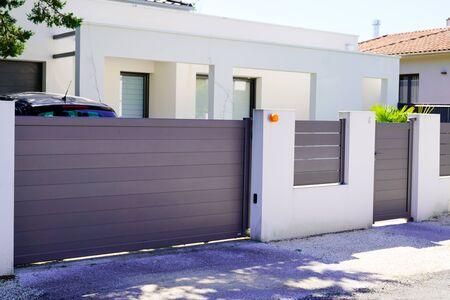 Photo for street suburb home grey brown dark metal aluminum house gate slats garden access door - Royalty Free Image