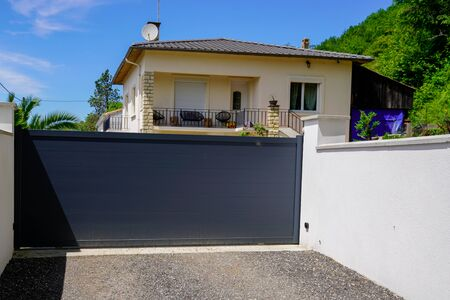 Photo for Aluminum dark gray metal gate to house with portal black to access home - Royalty Free Image