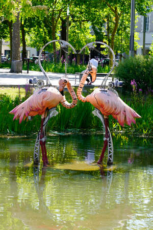 La Roche-sur-Yon,, vendee / France - 09 01 2020: flamingoes couple pink one of the animals of the place is a mechanical menagerie in french city of La Roche sur Yon