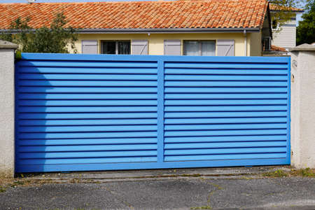 Photo for Blue classic portal sliding modern house gate door to access garage home garden - Royalty Free Image