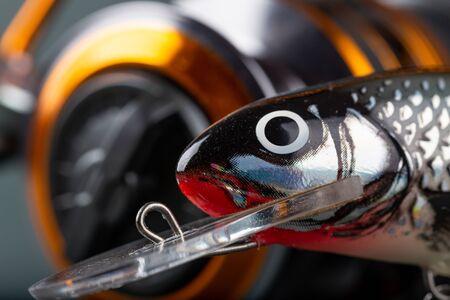 Photo pour Fishing lures close-up. Wobbler, reel, fishing line in bright color. - image libre de droit