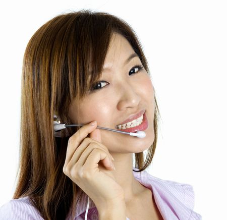 Friendly Customer Representative with headset smiling during a telephone conversation.