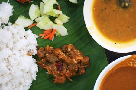 Delicious Indian cuisine spicy banana leaf rice