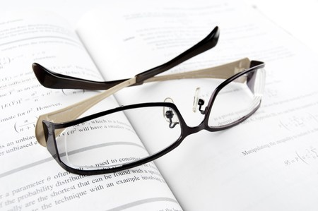 Pair of Glasses on the Mathematics Book