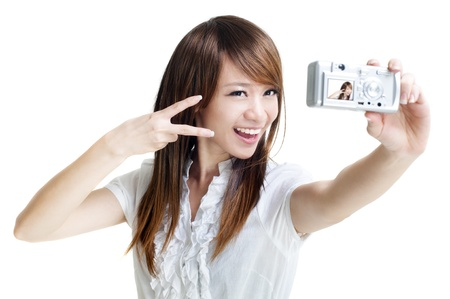 Asian girl self photographing, isolated on white