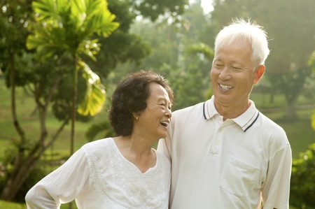 Asian Senior Couple having conversation at outdoor park