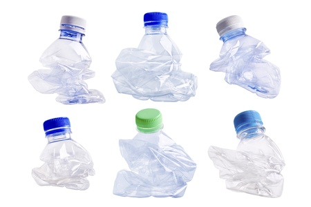 Collection of squashed plastic bottle on white background