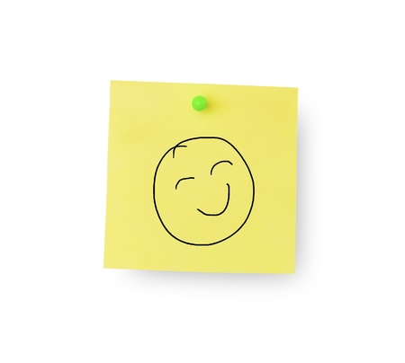 Smiley face on sticky memo notes on white background