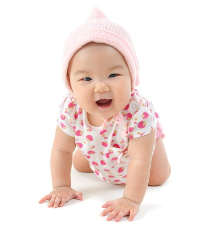 Six months old baby girl crawling over white background