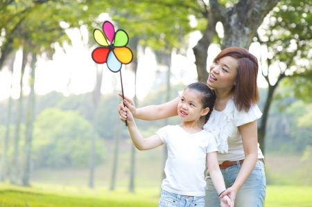 Photo for Asian family playing windmill at outdoor park - Royalty Free Image