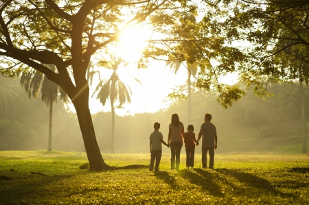 Photo for Asian family holding hands and walking towards light - Royalty Free Image
