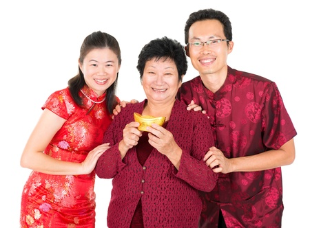 Happy Chinese New Year. Asian Chinese family greeting, holding a gold ingot isolated on white background