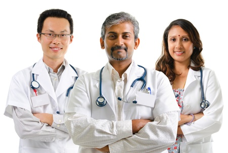 Multiracial doctors / medical team crossed arms standing on white background