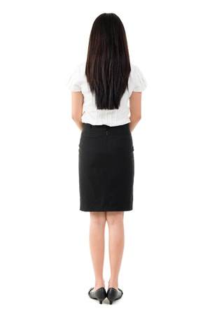 Full body rear view of beautiful Asian young girl with long black hair standing on white background