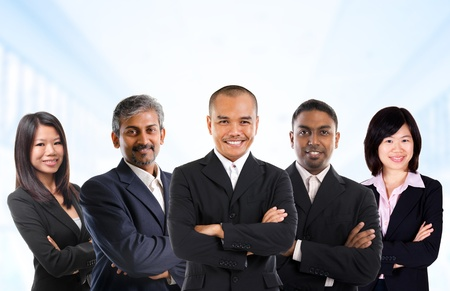 Foto de Asian business person in multiracial. Diversity business people form by different races, Indian, Malay, Indonesian, Chinese standing in office environment. - Imagen libre de derechos