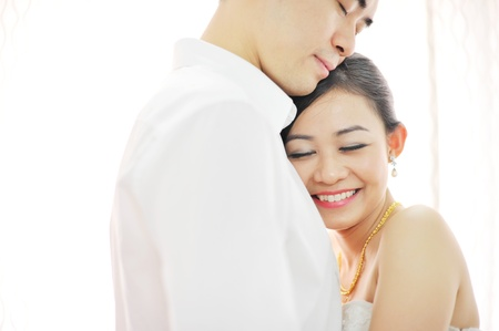 Asian Chinese wedding couple in love. Romantic groom and bride dancing in their wedding day