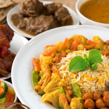 Indian cuisine biryani rice and curry.