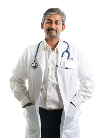 Mature Indian male medical doctor standing isolated on white background