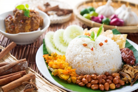 Nasi lemak, popular Malaysian food dish served with chicken rendang.