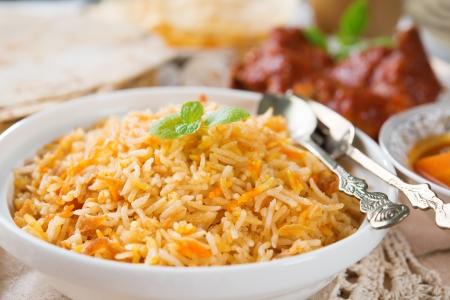 Biryani rice or briyani rice, fresh cooked, traditional indian food on dining table.