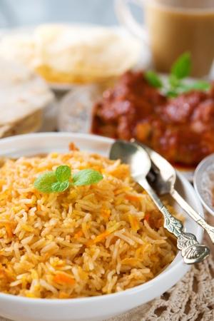 Indian cuisine biryani rice and chicken curry.