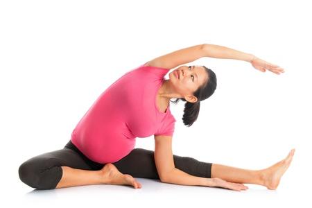 Prenatal yoga. Full length Asian pregnant woman doing yoga exercising stretching, fullbody isolated on white background.