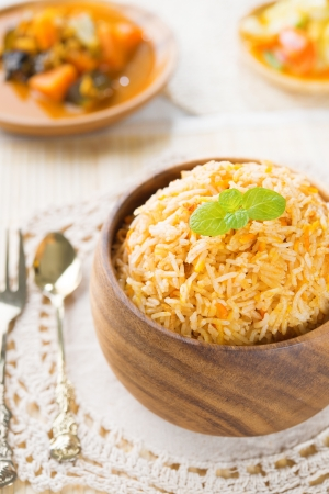 Indian vegetarian food. Biryani rice and curry dhal on dining table.