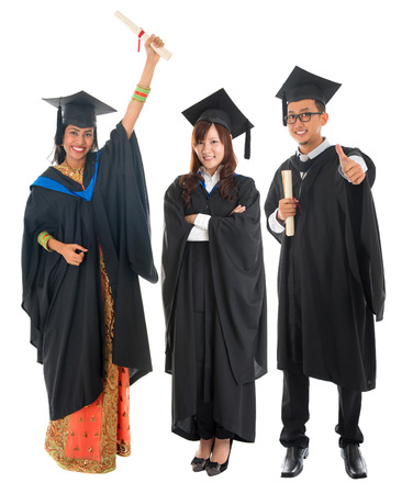 Full body group of multi races university student in graduation gown standing isolated on white background