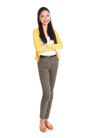 Portrait of an Asian woman smiling, full length standing isolated on white background.