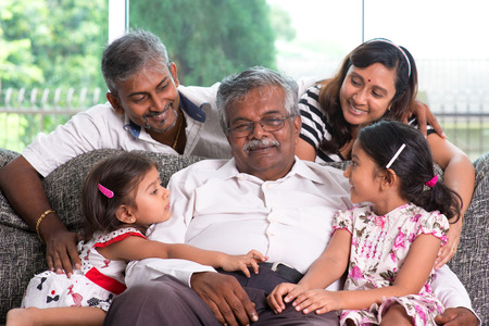 Portrait of multi generations Indian family at home. Asian people living lifestyle.