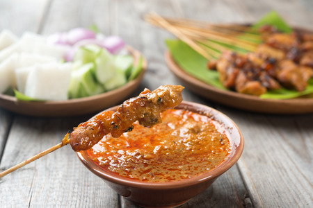 Malaysian chicken satay with delicious peanut sauce, one of famous local dishes.の写真素材