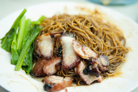 Popular Malaysian Chinese street food, wantan mee, kind of noodles serve with dumpling.